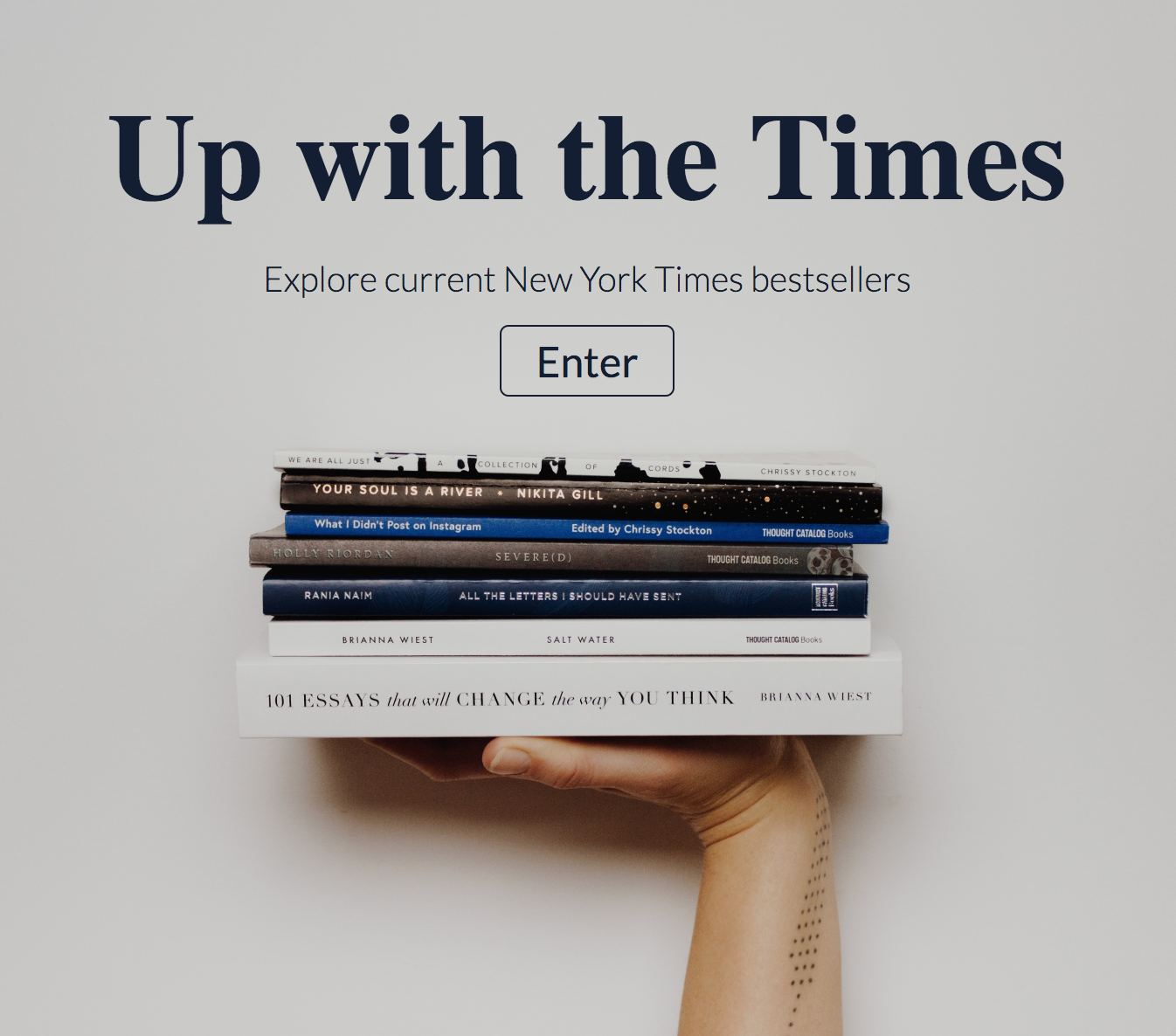 screenshot of up with the times home page, background has a womans hand holding up a pile of books with an enter button.